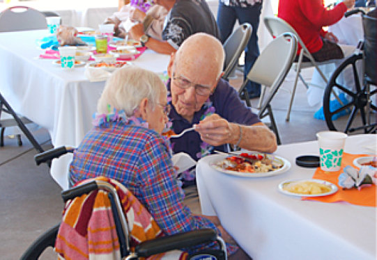 elderly people having meal