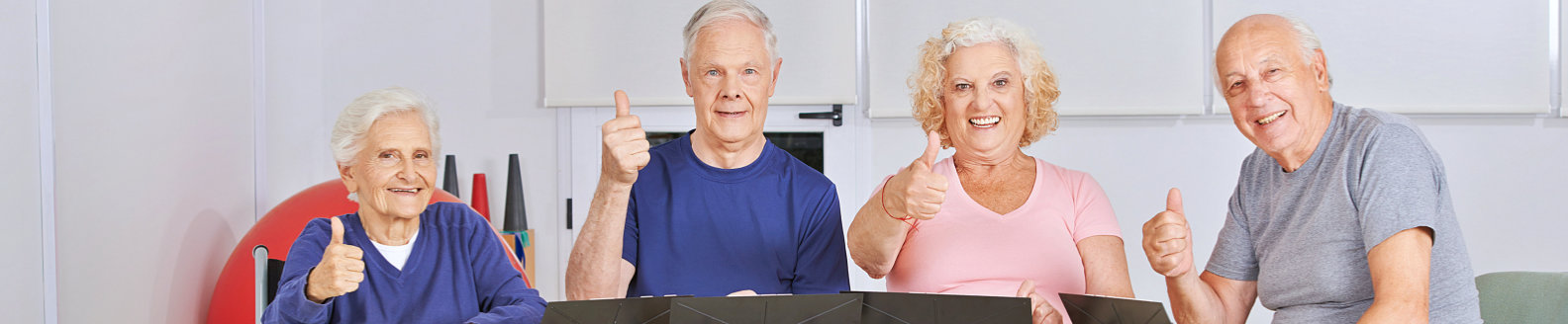 elderly people showing thumbs up