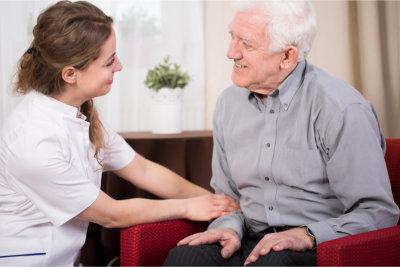 caregiver having conversation with elderly man