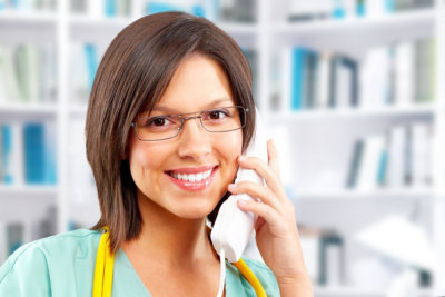 nurse using telephone